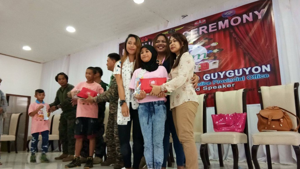 During the moving up ceremony where Kaye Koo of SinagTala Foundation helped in disseminating the Nutri10Plus and DayCee vitamin pouches to the kids